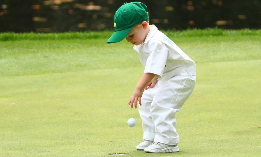Little boy caddie at the Masters Par-3 contest